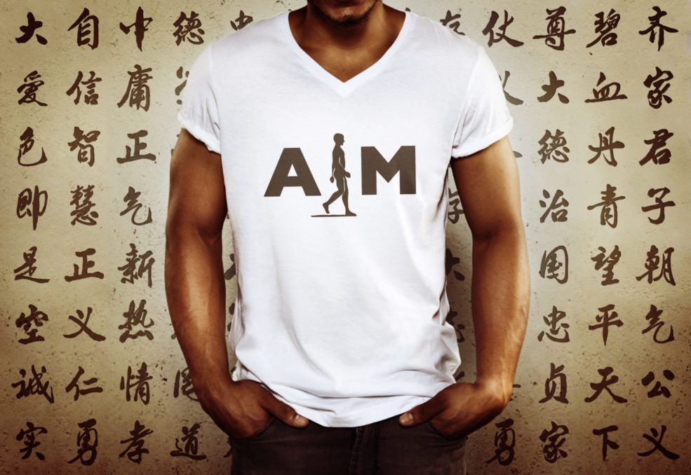 Young man wearing aim attitude white t-shirt